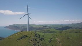 Aerial Revealing Shot Wind Turbine Generators 4k. Clean green energy generations, 4k aerial footage on cliff lines stock video