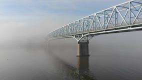 Aerial Rise Up Morning Foggy Bridge Over Ohio River. An aerial rising establishing shot of a bridge over the Ohio River on a foggy morning. Pittsburgh suburbs stock video