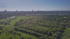 Aerial rising shot of the Moscow cityscape from Kolomenskoe park. Aerial rising shot of Moscow from Kolomenskoe park royalty free stock image