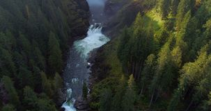 River flowing through green cliff 4k. Aerial of river flowing through green cliff 4k stock footage