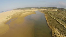 Aerial from the river and ocean at Carrapateira Portugal stock video