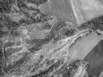 Aerial of roads; forest and pastures. Aerial black and white view of a road in the forest near pastures on the island of Sao Miguel, Azores stock images