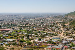 Aerial or rock view of African town Lubango with colorful houses in Angola. Aerial or rock view of African town Lubango in the interior of Angola Royalty Free Stock Photo