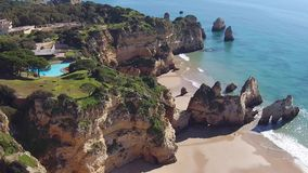 Aerial from rocks and ocean in Alvor the Algarve Portugal stock video footage