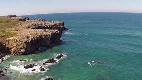 Aerial from rocks and ocean in Portugal stock video