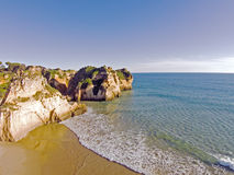 Aerial from rocks and ocean at Praia tres Irmaos in Algarve Port Stock Images
