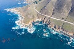 Aerial of Rocky Coastline in California on Beautiful Day royalty free stock image