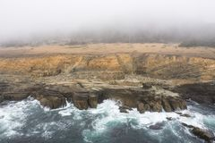 Aerial of Rocky Coastline of Northern California in Sonoma. The Pacific Ocean washes against the wild, rocky coast of northern California. This beautiful region royalty free stock images