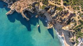 Aerial. Rocky shore formation and beaches of Portimao. View from sky. Stock Image