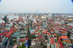 Aerial rooftop view of crowded Hanoi Vietnam houses showing living conditions. royalty free stock photo