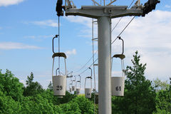 Aerial ropeway. Cabins over trees, Kharkiv Stock Image