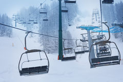 Aerial ropeway with empty chairlifts at ski resort Royalty Free Stock Images