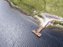 Aerial of the rotten old pier on the shores of Loch Etive Stock Images