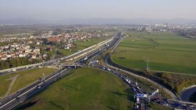 AERIAL: roundabout over highway stock video footage