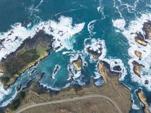 Aerial of Rugged Mendocino Coastline in California. The cold waters of the Pacific Ocean wash against the rocky coastline of Sonoma in northern California. This stock images