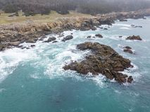 Aerial of Rugged Northern California Coastline. The cold, nutrient-rich waters of the Pacific Ocean wash against the rocky northern California coastline in stock images