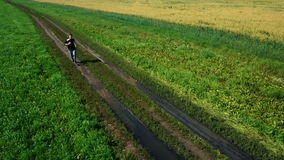 AERIAL: Running athlete man. Male runner jogging outdoor. Sport. stock footage