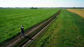 AERIAL: Running athlete man. Male runner jogging outdoor. Sport. stock video