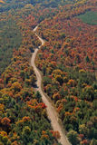 Aerial rural Wisconsin autumn road. An fall aerial of a winding rural road road and fall colors in West Central Wisconsin royalty free stock photography