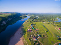 Aerial Russian countryside in a picturesque landscape among mountains and rivers Stock Photos