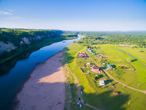 Aerial Russian countryside in a picturesque landscape among mountains and rivers Royalty Free Stock Photo