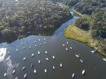 Aerial of Sailboats Moored in Calm Bay on Cape Cod. Dozens of sailboats are moored in a calm saltwater pond on Cape Cod, Massachusetts. Especially during summer Royalty Free Stock Images