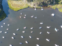 Aerial of Sailboats Moored in Calm Bay on Cape Cod. Dozens of sailboats are moored in a calm saltwater pond on Cape Cod, Massachusetts. Especially during summer Royalty Free Stock Image
