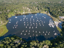 Aerial of Sailboats Moored on Cape Cod, Massachusetts. Dozens of sailboats are moored in a calm saltwater pond on Cape Cod, Massachusetts. Especially during Royalty Free Stock Images