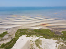 Aerial of Sand Flat on Cape Cod, MA. Low tide exposes a vast sand flat at a scenic beach on Cape Cod, Massachusetts. This sandy peninsula is a popular summer Royalty Free Stock Photos