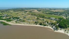 Aerial scene with beach drones. The camera zooms in towards the coast.