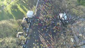 Aerial scene with drones. Aerial camera travels forward of marathon by avenue. Palermo.