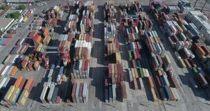 Aerial scene with drones. Container terminal of the port. Camera down with a view of ship and containers. Central plane.