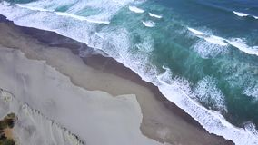 Aerial scenery of beach with frothy wave stock footage