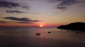 Aerial scenery of sunset above the sea stock video footage