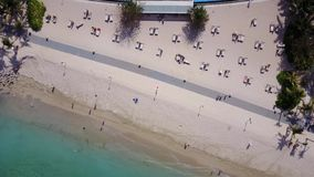 Aerial scenery of swimming pool at beach. Beautiful aerial scenery footage of swimming pool at Nusa Dua beach from a drone flying backward in Bali, Indonesia stock footage