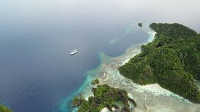 Aerial of Scenic Islands in Raja Ampat. The scenic limestone islands in Wayag, Raja Ampat, are surrounded by healthy, shallow coral reefs. This remote, tropical stock video