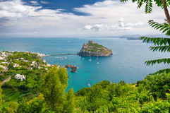 Aerial scenic view on Aragonese castle through foliage, Ischia, Italy Stock Image
