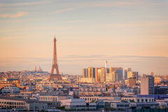 Aerial scenic view of Paris with the Eiffel tower at sunset, Montmartre in the background, France city travel concept Stock Photos