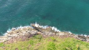Aerial: sea shore cliff and blue waves. Phuket Island, Thailand. 4K. Aerial: sea shore cliff and blue waves. Phuket Island, Thailand. 4K stock video footage