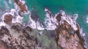 Aerial sea wave with rock beach Royalty Free Stock Photo