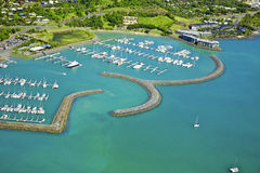 Aerial of seaside town in Whitsundays. Aerial of Airlie Beach in Queensland Australia. Looking down from above at a seaside town surrounded by boats in the Stock Images