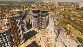 Aerial shoot of construction site with tower cranes. Construction drone footage. Aerial shoot of construction site with tower cranes.The construction of the stock video footage