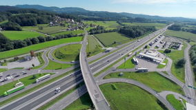 Aerial shoot of a highway near the town. Aerial shoot of a highway with exits near a small town and with a big gas station on a highway road stock video footage