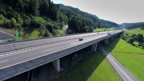 Aerial shoot of a highway road bridge with traffic stock video footage