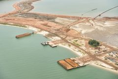 Aerial shoot of a lake coast with sand mining stock image