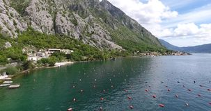 Oyster farming in Montenegro. Aerial shoot of oyster and mussel farming with traps and buoys in Boka-Kotor bay, Montenegro, the Adriatic coast in the springtime stock footage