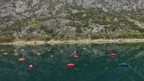 Aerial shoot of plantation for growing shells, mussels and oysters. In the Bay of Kotor stock footage