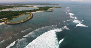 Aerial shoot of the Serangan beach. With waves and foam, Indonesia stock footage