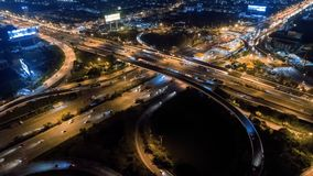 Aerial shoot top view circle road Traffic in city at night, 4K, time lapse, bangkok , thailand. stock footage