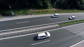 Aerial shoot of traffic on a highway. Aerial shoot of a highway and cars and trucks passing by in a valley stock footage